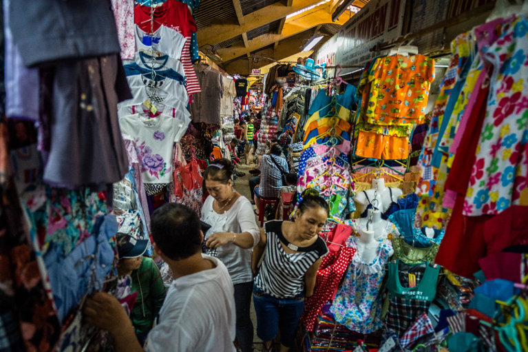 Shop owners see a rise in sales as better roads bring in more customers. Photo: ADB.